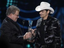 Brad Paisley, right, is presented his CMT Artists of the Year award by actor William Shatner during a taping for the Dec. 13 show.