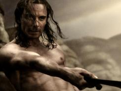 Abs make the slayer in '300,' in which MIchael Fassbender stars as Stelios.