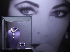 A Cartier necklace and Bulgari ear pendants are among  Elizabeth Taylor's personal possessions that will be auctioned by  Christie's,