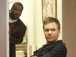 Joel McHale, right, with Levar Burton, stars in NBC's Community