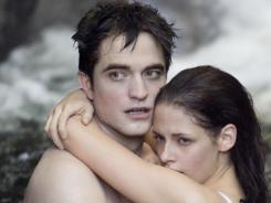 The love story of Edward (Robert Pattinson) and Bella (Kristen Stewart) lifted the vampire tale to its third straight week atop the box office.