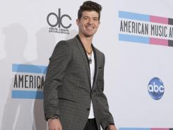 Robin Thicke, who attended the 2011 American Music Awards in Los Angeles last month, has a new album called 'Love After War.'