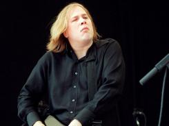 Canadian blues guitarist Jeff Healey and his band perform in New York's Central Park on July 1, 2000.