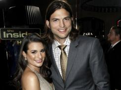 Lea Michele and Ashton Kutcher arrive at the premiere.