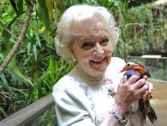 She's just ducky:  Betty White with a Mandarin duck at the Central Park Zoo.