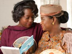 Best friends Aibileen Clark (Viola Davis) and Minny Jackson (Octavia Spencer) share a special moment  in 'The Help.'