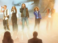 Still alive, until tomorrow night, anyway: Chris Rene, left, Melanie Amaro, Josh Krajcik, Rachel Crow and Marcus Canty.