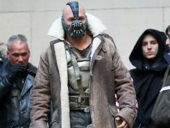 Tom Hardy stars as Bane in 'The Dark Knight Rises,' filmed on location on Wall Street in New York City.