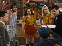 'Girls' and guys: Matthew Moy, left, Jonathan Kite, Kat Dennings, Beth Behrs and Garrett Morris (in beret) talk to director Fred Savage on the diner set.