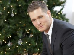 Michael Buble has been dominating USA TODAY's music charts with songs from his album 'Christmas.'
