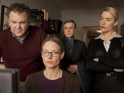 Parent-parent conference: John C. Reilly, left, Jodie Foster, Christoph Waltz and Kate Winslet meet to discuss their sons' fight.