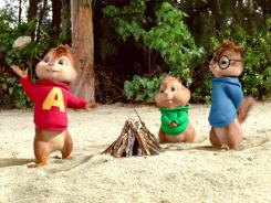 Marooned on a remote island, Alvin, left, Theodore and Simon try to make a fire.