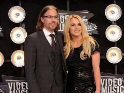 Britney Spears is engaged to her former manager Jason Trawick.