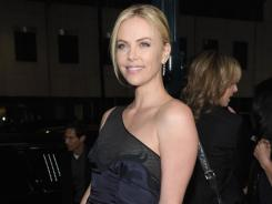 Charlize Theron, in a sleek Stella McCartney dress, debuted her new film, 'Young Adult', Thursday in Los Angeles.