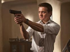 Cocked and loaded: Jeremy Renner plays Brandt in the latest 'Mission: Impossible' movie.