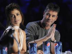 Paula Abdul and Simon Cowell hold court at the judges table on 'X Factor.'