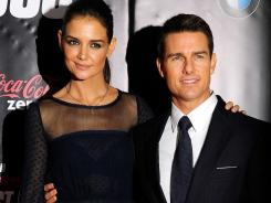 Holmes and Tom Cruise selected color-coordinated ensembles for the 'Mission: Impossible - Ghost Protocol' premiere Monday.