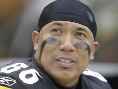 Pittsburgh Steelers receiver Hines Ward takes a run in the new Batman film.