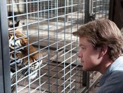 Ride the tiger:  Matt Damon plays a widower with two children who takes a big gamble by purchasing a dilapidated zoo in Cameron Crowe's latest film.