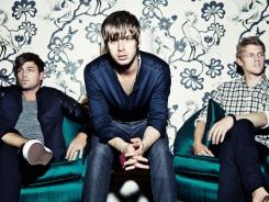 Cubbie Fink, left, Mark Foster and Mark Pontius are indie pop band  Foster the People.