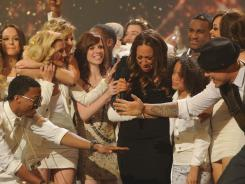 A tearful Melanie Amaro is congratulated by her fellow  'X Factor' contestants after being crowned the Season 1 winner.