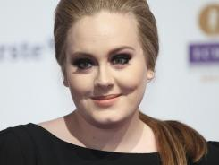British singer/songwriter Adele has two songs on Earworm's 2011 mashup:  'Rolling in the Deep' and 'Someone Like You.'