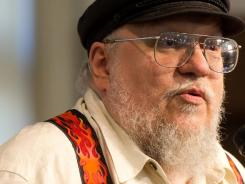 Author George R.R. Martin at a book signing for 'A Dance with Dragons' in New York.