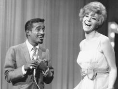In this Jan. 6, 1967, file photo, Sammy Davis Jr. and Kaye Stevens perform on a TV show.