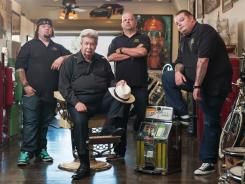 "'Pawn Stars': Austin ""Chumlee"" Russell, left, Richard Harrison, Rick Harrison and Corey Harrison helped History's ratings climb 18% over last year."