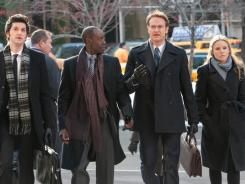 Don Cheadle, second left, is a business consultant who, along with his minions (Ben Schwartz, elft, Josh Lawson and Kristen Bell) help executives justify their lavish bonuses and other semi-shady tasks.