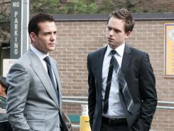 USA's freshman summer series 'Suits,' starring Gabriel Macht, left, and Patrick J. Adams, soared to No. 8 for the year.