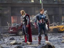 Chris Hemsworth, left, and Chris Evans reprise their roles as Thor and Captain America in Marvel's 'The Avengers.'