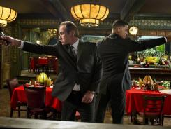 Tommy Lee Jones, left, and Will Smith return to the big screen as the 'Men in Black' on May 25 for the first time in a decade.
