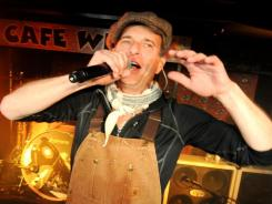 David Lee Roth and company perform at Cafe Wha? in New York. The band announced their  North American tour and upcoming release of a new album.