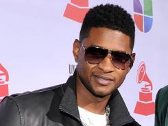 Usher is singing and dancing in the Latin style.