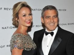 Still going to act surprised: Stacy Keibler and George Clooney attend the 2011 National Board of Review Awards in New York on Tuesday.