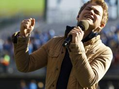 Hunter Hayes sings the national anthem Dec. 31 before the Illinois-UCLA game at AT&T Park in San Francisco.