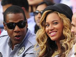 Proud parents: Jay-Z and Beyonce's daughter, Blue Ivy Carter, is already a pop culture phenom.