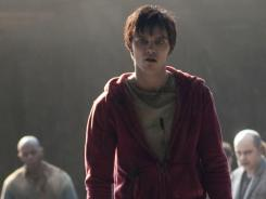 That's one way to meet: Zombie Nicholas Hoult falls in love with a girl after eating the brains of her dead boyfriend.
