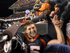 Tim Tebow and Denver fans rejoice after their overtime playoff win against Pittsburgh. The CBS game pulled in 42.4 million. viewers.
