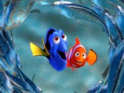 Dory (Ellen DeGeneres) and Marlin (Albert Brooks) head out to sea in 'Finding Nemo.'.