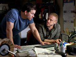 "They pull me back in: Mark Wahlberg, left, and Ben Foster can't save 'Contraband' from the tired ""one last job"" trope."
