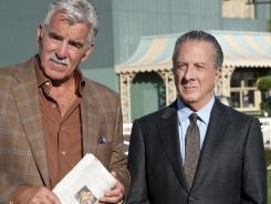 Gus (Dennis Farina, left) and Ace (Dustin Hoffman) evaluate their equine charges on HBO's racetrack drama 'Luck.'