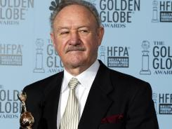 Gene Hackman holds the Cecile B. DeMille Award in this Jan. 19, 2003 photo at the 60th Annual Golden Globe Awards in Beverly Hills, Ca.