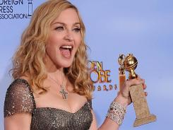 Madonna shows off her Golden Globe for best original song, 'Masterpiece,' from her film 'W.E.'