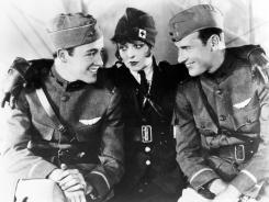"Out on Blu-ray and DVD next week: Charles ""Buddy"" Rogers, left, Clara Bow and Richard Arlen deal with love and friendship during World War I in 'Wings.'"