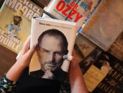 Alison Weiss looks at a copy 'Steve Jobs' at the Books & Books store in Coral Gables, Florida, one of the highest selling books of the year.