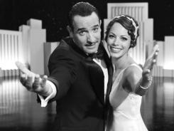 Jean Dujardin and Berenice Bejo are the stars of 'The Artist,' which took the top prize at Saturday's Producers Guild Awards.
