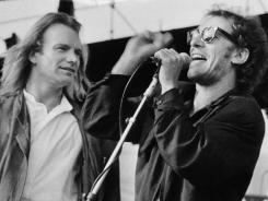 Sting, left, and Bruce Springsteen perform during the Amnesty International Human Rights Now concert in Philadelphia in September 1988.