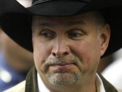 Garth Brooks will get his $500,000 donation to IntegrisCanadian Valley Regional Hospital in Yukon, Okla., back, plus $500,000 in damages.
